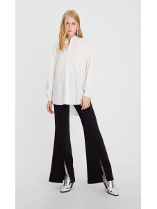 Flared trousers with opening Stradivarius